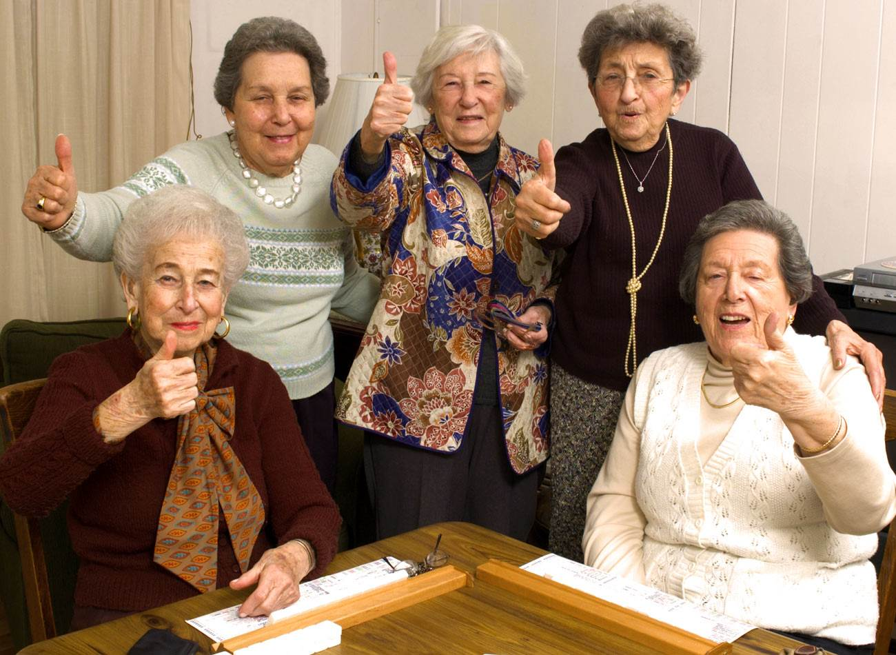Women giving thumbs up