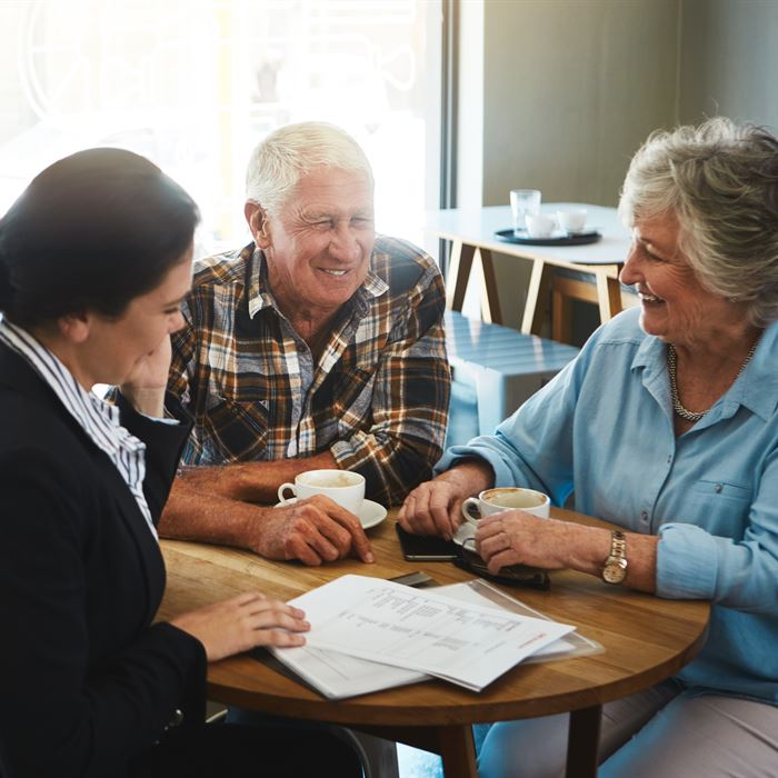 Senior living consultant having a meeting with an elderly couple